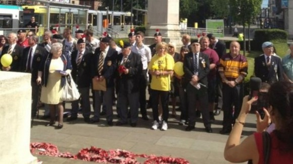 Families and former servicemen at the Manchester cenotaph