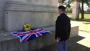 An ex-serviceman pays his respect in Leicester.
