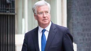 Fallon: UK sending specialists for migration mission.
