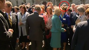 Gerry Adams is just visible at the back of the crowd.