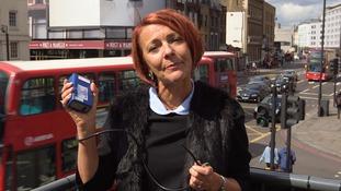 woman holding air sampler
