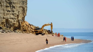 Rescue workers at the scene of the Burton Bradstock Landslide in Dorset