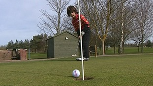 Six-year-old golfer who aims to beat Tiger Woods