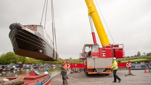A B Tuckey Boat Transport Service is pictured craning ABC Leisure's 72ft-long 'Dawn Til Dusk' narrowboat.