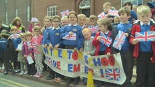 School children line the streets to cheer the troops