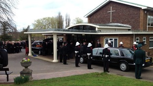Funeral cortege arrives at crematorium in Stafford.