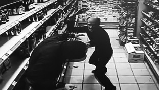Shopkeeper Neil Hanby tackled the man with a bottle of champagne