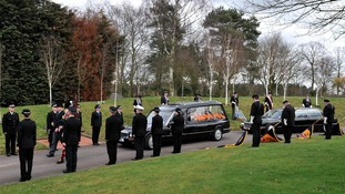 Police form a guard of honour as the coffin of David Rathband arrives at the Stafford Cremetoriam