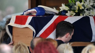 The coffin of PC David Rathband is carried into the Stafford Crematorium.