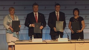 EU and Ukrainian officials signed the agreement at the European Partnership Summit in Riga.
