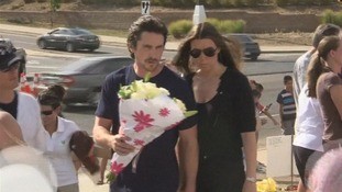 Batman star Christian Bale visits Denver shooting victims