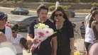 Christian Bale and his wife Sibi visit a make shift memorial to the Aurora victims.