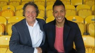 Mansfield Town have re-signed striker Matt Green.