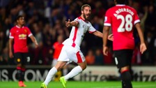 Will Grigg celebrates scoring against Man Utd.
