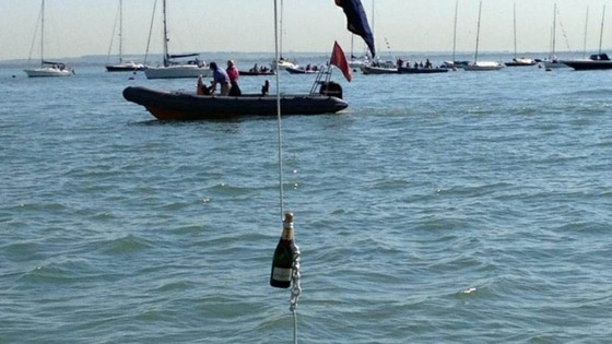 A bottle of champagne hangs off a boat on the Isle of Wight as the Island prepares for the Queen