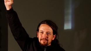 Podemos leader Pablo Iglesias raises his fist