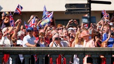 Crowds turn out to see the Queen
