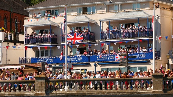 Crowds pack every available space in Cowes to see the Queen