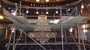 The chandelier has been lowered into the auditorium.