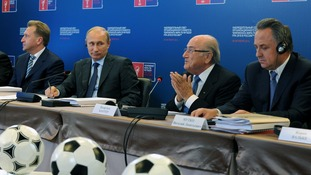 Russian president Putin sits with FIFA president Sepp Blatter