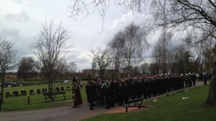 Police line up after the humanist funeral ceremony of PC David Rathband