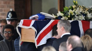 Pallbearers carrying the coffin of PC David Rathband into Stafford Crematorium