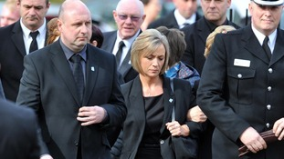 Kath Rathband arriving at her estranged husband's funeral