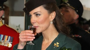 The Duchess of Cambridge holds a glass of Harvey's Bristol Creme.