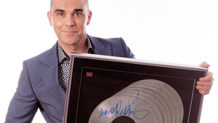 Everything changes: Robbie Williams flogs 'prized possessions' for children's charity