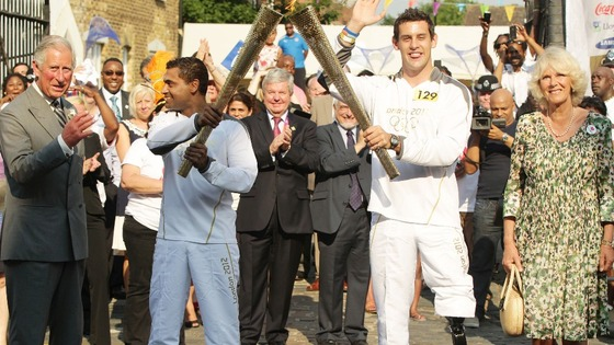 Duchess of Cornwall and the Prince of Wales with Torchbearers 127 Jay Kamiraz and 129 Scott Moorhouse