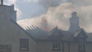 The fire ripped through the roof of the building