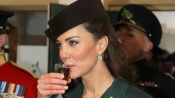 The Duchess of Cambridge holds a glass of Harvey's Bristol Creme in the Junior's Mess as she visits Aldershot Barracks.