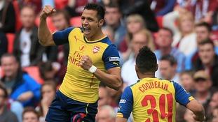 Alexis Sanchez celebrates scoring the second goal.