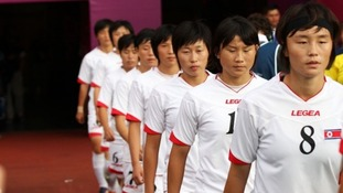 North Korea return to the pitch following the flag error.