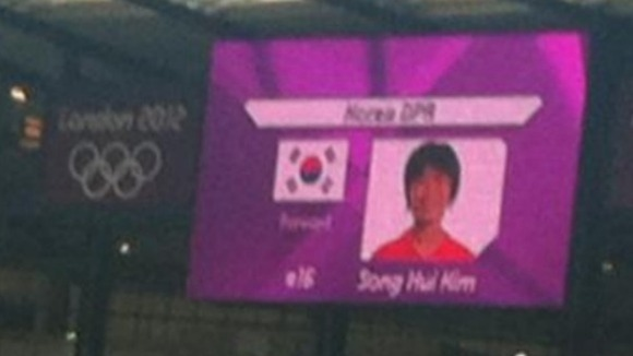 The South Korean flag on a television screen in the stadium