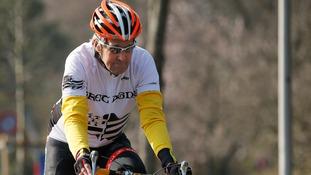 John Kerry riding his bike in Geneva in March.
