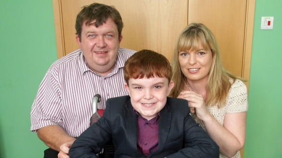 Ciaran Finn-Lynch with his parents Colleen and Paul.