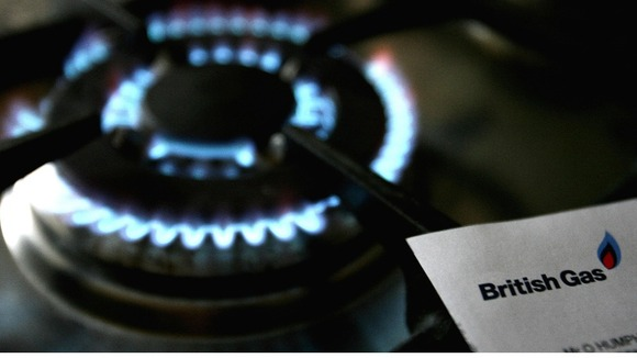 Gas hob with a British Gas bill as British Gas profits warm up