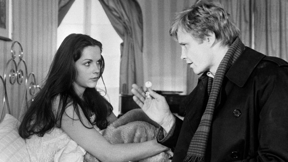 "Mary Tamm and American actor Jon Voight in a scene from the thriller ""The Odessa File"""