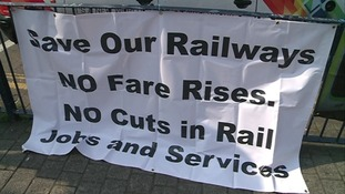 Protest banner outside Birmingham New Street station