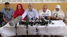 Tariq Jahan with family members at today's press conference