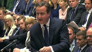 David Cameron faces the Commons at PMQs