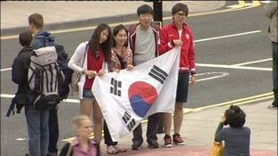 Fans hold the South Korean flag
