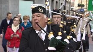 Bagpipe player taken part in parade in Derby