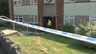 Policeman outside house in Swansea