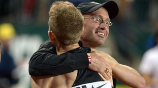 Galen Rupp embraces coach Alberto Salazar.