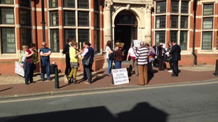 Campaigners gather outside meeting