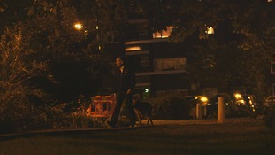 man with dog at night