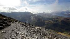 Hikers climbing Ben Nevis.