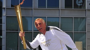 Sir Bruce Forsyth with Olympic flame